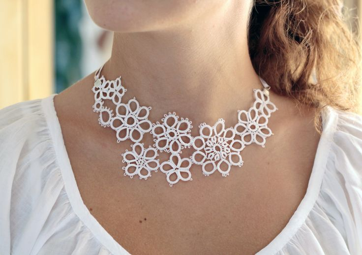 Bridal accessory: handmade tatted floral necklace in pure white - asymmetrical lace decoration. €30.00, via Etsy.