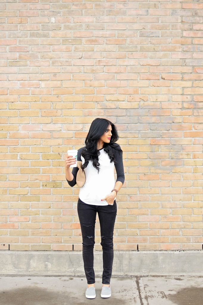 baseball tee and black distressed jeans