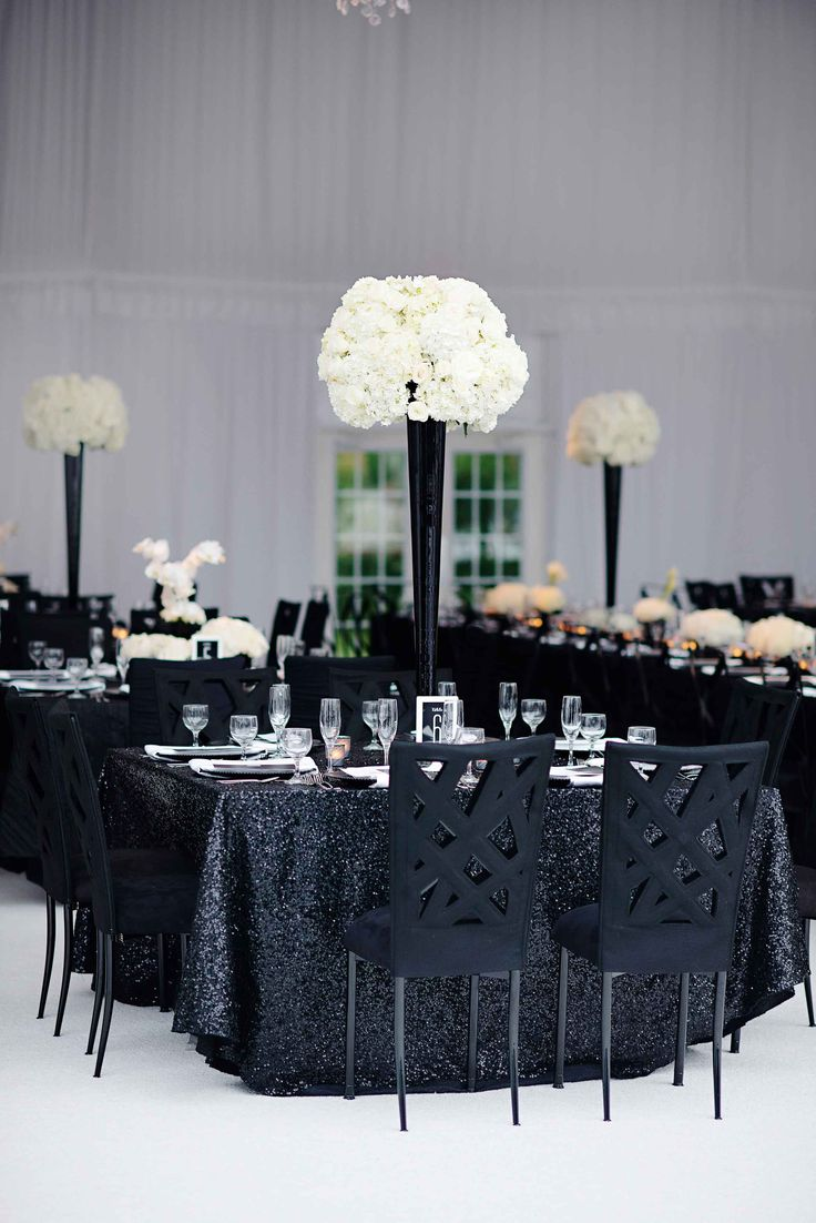 Tall Black & White Centerpiece on Sequined Linen | Photography: Kortnee Kate. Read More: http://www.insideweddings.com/weddings/black-and-white-modern-wedding-with-unique-details-in-cincinnati/698/