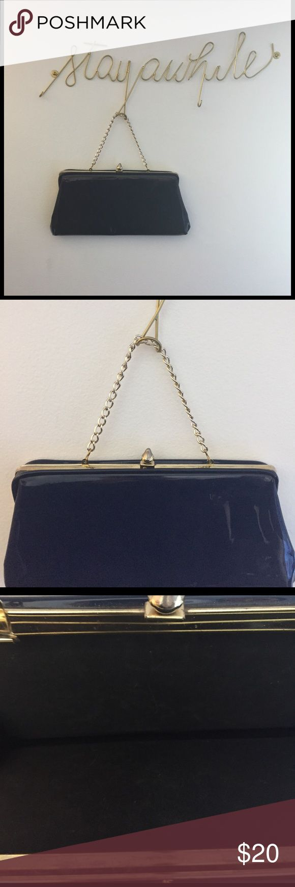 "60s Vintage Navy Clutch bag Such a good find, I bought these bag many years ago in a vintage market. From the 60s Navy with a Gold clasp. The small chain can be placed inside to create a clutch bag, or left to wear....chain 5"" length 11.5"" width 5.5"" Bags Clutches & Wristlets"