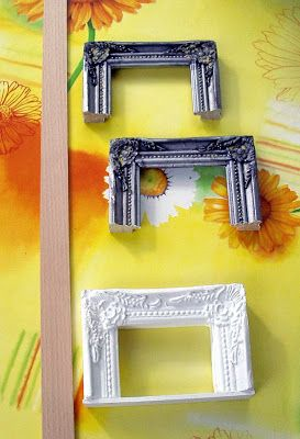 Cut picture frame in half to make fireplace.  I would add bricks or stone inside.