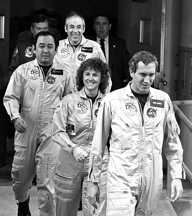 The crew of the Space Shuttle Challenger, including Christa McAuliffe (second, behind pilot Michael Smith)