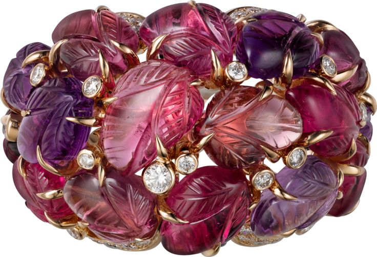 CARTIER. Ring with engraved stones, 18K pink gold, set with, amethysts, garnets, onyx and 69 brilliant-cut diamonds totaling 0.99 carats.