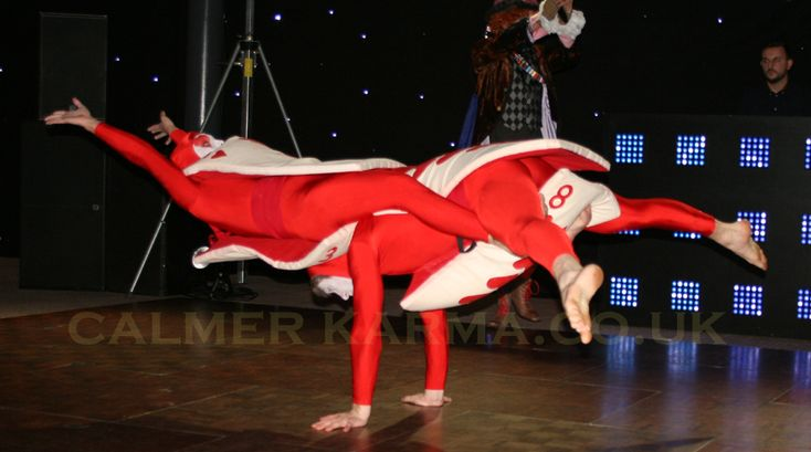 Red Card Acrobalance - choreographed stage act for Alice in Wonderland themed events.