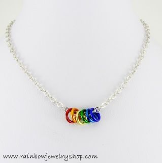 Small aluminum rings dangle from a 20 inch chain. Chain length can be adjusted if needed.