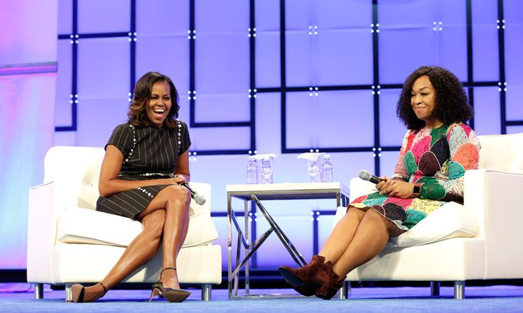 Michelle Obama was all smiles as she chatted with friend Shonda Rhimes during the Pennsylvania Conference for Women on October 3.  During the panel, which was held on the former first lady's 25th wedding anniversary, Michelle was surprised by her husband with a loving message.