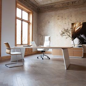 Senor Executive office includes inviting meeting tables, adapted for today's technology.