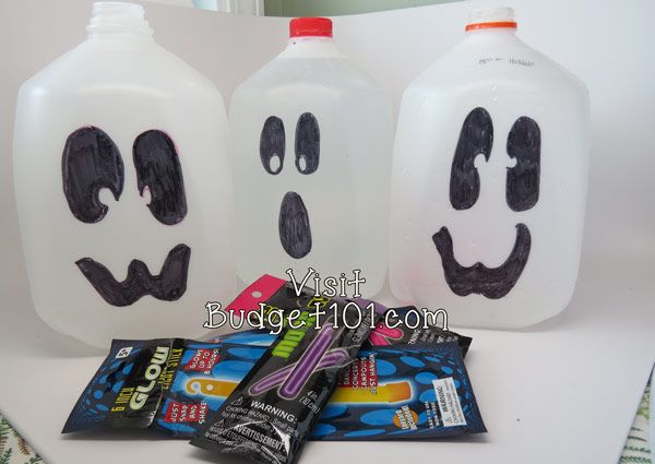 Homemade Ghostly Lanterns on Budget101.com - milk jugs decorated with Sharpies, fill with water and add a glow stick.