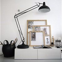 idea for the home: white cabinet + rubber basket + wooden frames
