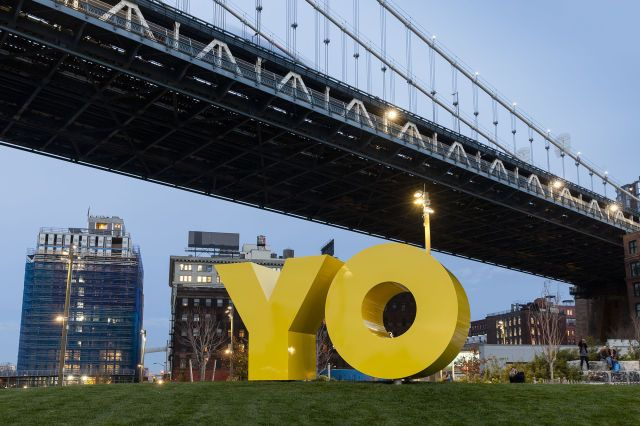 """The piece reads as """"OY"""" if you are viewing it from Brooklyn and as """"YO"""" if you are looking across the river from Manhattan. It's two simple letters, but packed into them is a commentary on linguistics, gentrification, and the power of social media. In a little over six months, it's become part of the New York skyline."""