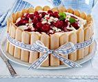 Mango-Käsesahne-Torte Rezept: Eier,Salz,Zucker,Vanillin-Zucker,Mehl,Speisestärke,Backpulver,Gelatine,Mangos,Magerquark,Bio-Zitrone,Schlagsahne,Bestäuben,Backpapier