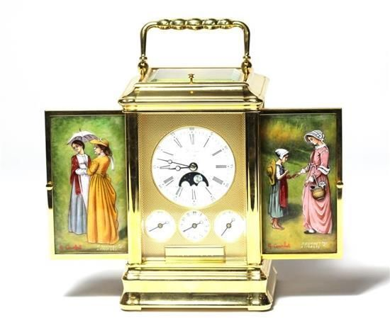 <b>A L'Epee 150 year Anniversary Carriage Clock,</b> Made in 1989 to celebrate the 150th anniversary of the Maison L'Epee.  Limited Edition 34/150.  Enamel dial with roman numerals, aperture for moon phase and lunar calendar.  Three subsidiary dials for day, date and alarm.  Brass gilt case with side doors set with Limoges painted on enamel panels of ladies by enamellers P. Bonnet and Gustave Courbet.  Rectangle brass movement with half and hour strike and a two tune musical movement…