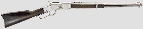 """Winchester M 1873, Saddle Ring Carbine, Kal. 44-40, Nr.274080B (Baujahr 1888). Lauf mit geprägter Hersteller- und Kaliberangabe, verstellbare Visierung, seitlich britischer Beschuss. Rahmen linksseitig graviert """"R.B.Rodda & Co. London - 7 & 8 Dalhouse Square - Calcutta"""". Schäftung aus Nussbaumholz. Länge 98 cm."""