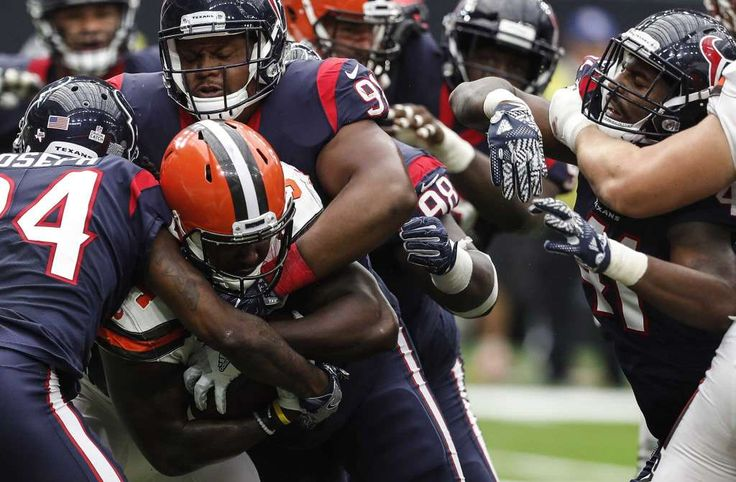 Cleveland Browns running back Isaiah Crowell (34) is stopped by Houston Texans cornerback Johnathan Joseph (24) and defensive tackle Carlos Watkins (91) during the third quarter of an NFL football game at NRG Stadium on Sunday, Oct. 15, 2017, in Houston. Photo: Brett Coomer, Houston Chronicle / © 2017 Houston Chronicle
