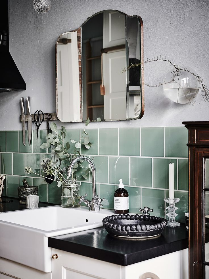 Monochrome with a pop of jade green - a vintage bathroom look with a modern twist