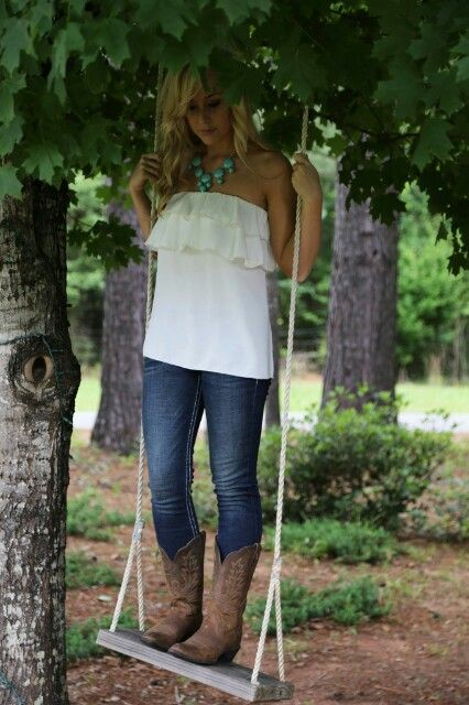 .cowboy boots, jeans, ruffled top & statement necklace