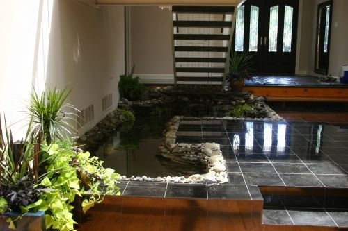 26 best images about under stairs deco on pinterest for Indoor koi fish pond