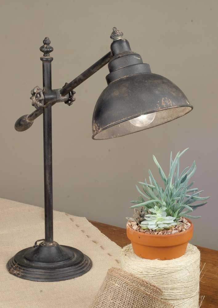 "Our Farmhouse Lamp has an 8"" dia. base and is about 30"" tall when extended fully upright. Lamp arm is adjustable and measures 21"" long. Arm swings and is adjustable and tightens in the middle of the a"