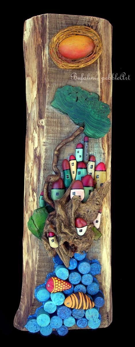 Paesaggio marino, realizzato mediante sassi dipinti, pezzi di legno levigati dal mare, tappi di sughero, scarti di pietre (malachite) Tutto assembla...