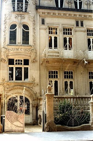 Art Nouveau ~ England  My comment: Actually I was skeptical that this building stands in England so I tried searching for it in Google. This might be in Esch sur Alzette, Luxembourg:  http://www.1902.info/city/view/id/11/l/en