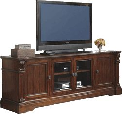 Ashley Alymere Extra Large TV Stand - With the rich rustic brown finish flowing beautifully over the scrolling ornamental detailing and elegant stacked moulding style, the Alymere entertainment collection offers a rich traditional design to enhance the decor of any home while giving you the function and storage you have been looking for in any entertainment furniture.