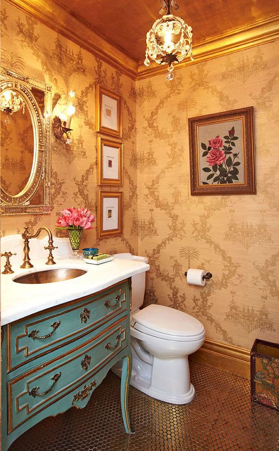 Jewelbox Powder room: Inspired by the sparkly powder room at Bemelmans Bar in Manhattan's Carlyle hotel, sheathed in Osborne & Little's gold-patterned chinoiserie wallpaper, gold-leafed ceiling, & floored in penny tiles.   --  Small Home. Big Style. - Traditional Home