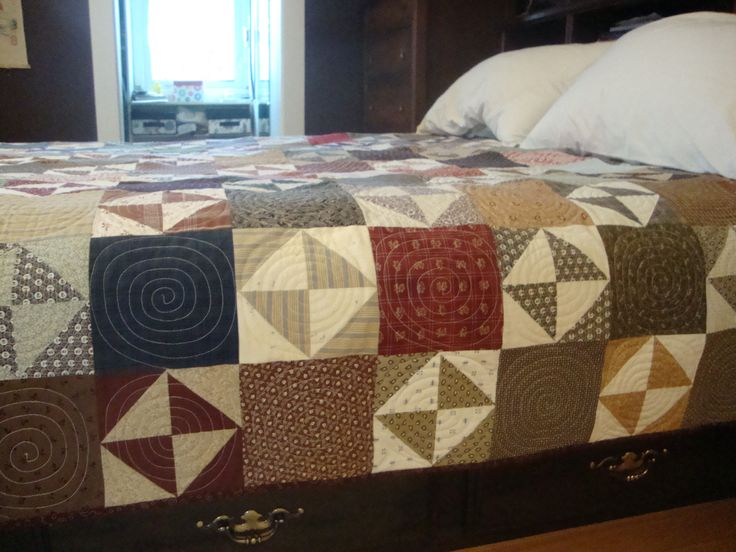 The lady who quilted this one did a beautiful job-circles in each block.  I loved the effect!