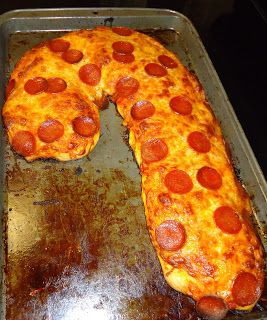 Silly but cute idea for our Christmas Eve,Polar Express movie night..boys will love it!  Homemade pizza in the shape of a candy cane for Christmas movie night!