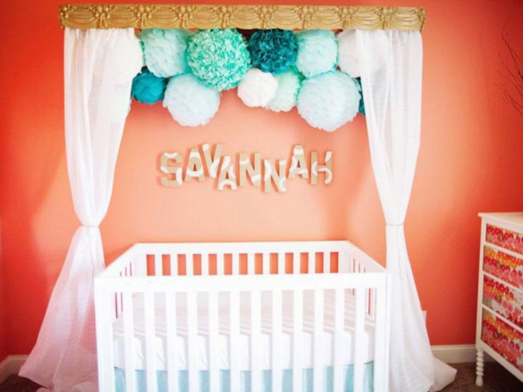 Inexpensive and easy to make, the tissue pom is a whimsical party favorite that can also add pizazz to a child's bedroom decor. Try incorporating different size poms and tissue paper in shades of the same color for maximum impact. Photo courtesy of ProjectNursery.com