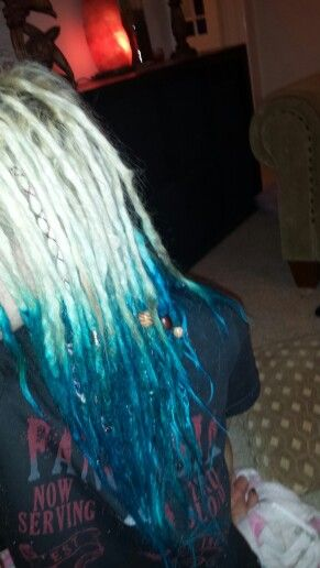 My blue mermaid dreads dip dyed dreadlocks. I used Directions Blue dye (I think it was Turquoise? The colour lasts A LONG TIME. It didn't seem to wash out for me, like 3 months later it was still going strong.So,yeah, bit o' advice and a warning if you're applying to white hair. :-P That aside, blue hair is awesome....very awesome