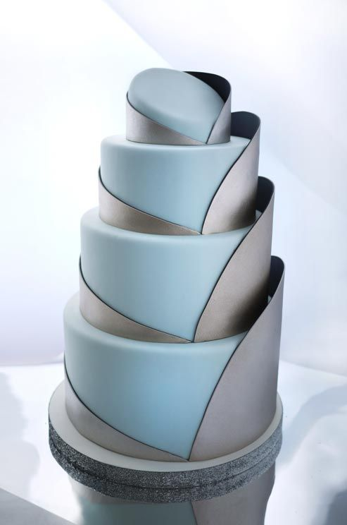 Ice-blue tiers emerge out of sleek silver swaths for a contemporary appeal.