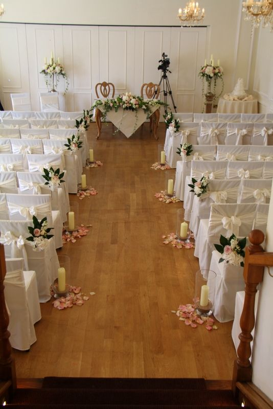 Civil Ceremony at West Tower in Aughton, two of our fabulous Baroque Candelabras framed the Registrars table which was dressed by a luscious candlelit traditional style design.