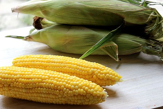 4 Minute Steamed Corn on the Cob ~ steamed in it's husks, slice the bottom off and shake out the cob.  Husks and silk slides right off, perfect steamed corn.  No boiling taking out all of the favor!!