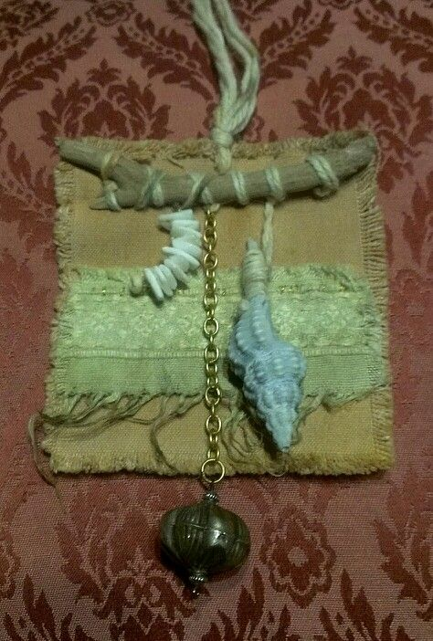 Jewellery. Amulet. Decoration. Driftwood, shell, eco dyed fabric remnant, tea dyed canvas, shell fragments, yarn, metal. By pocketdelight