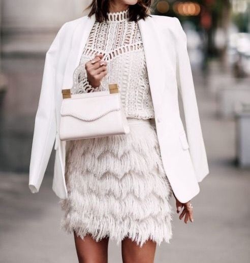 textures on textures. fringe skirt, lace top, smooth white blazer, structured bag