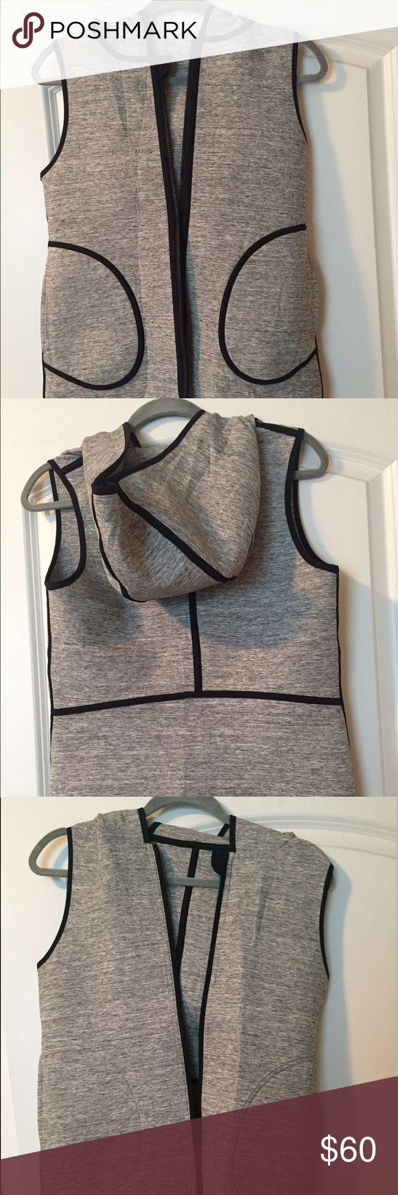 Lululemon vest. Fully reversible. Lululemon vest. Fully reversible, with pockets and hood. Black seems on one side, fully gray on the other. lululemon athletica Jackets & Coats Vests