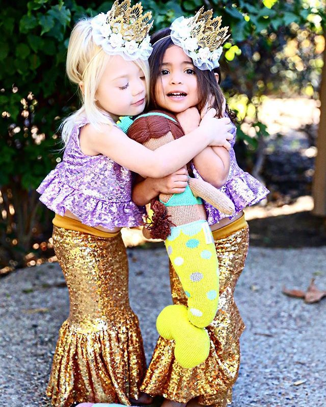 "When your bestie is cold  Tag your besties  ************************************************ Obsessed with these gold mermaid tails and lavender sequin tops from @carkendesign!! Her creations are amazing! @carkendesign  Gold flower crowns from one of our favorites @lovecrushbowtique! Just for our followers receive 10% off using our code ""EVERAVA"" on your entire purchase!! @lovecrushbowtique  Cutest Mermaid doll: @cuddleandkind  PC: @littleredrosephotography"