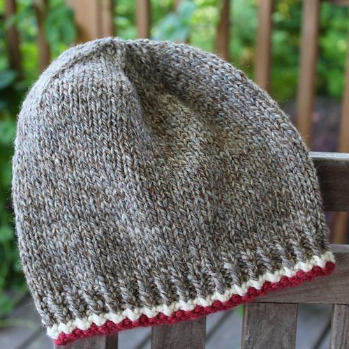 Reminiscent of that adorable sock monkey you loved as a child. A simple hat with just a smidge of color to bring out the monkey in you! Free pattern