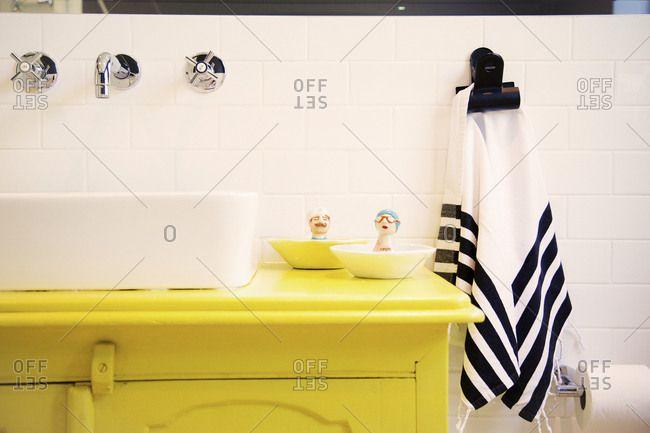 Bathroom vanity with ceramic figures beside the sink