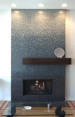 Awesome ombre tiling (though maybe too trendy to include in the home) but cool offset mantel.