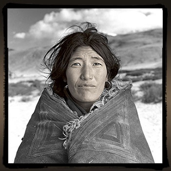 "changtang, Ladakh - ""Dolma (38) had never seen a westener up close before. She would reach out, touch my shoulder then quickly pull her arm back into her chuba and laugh"" - portrait by Phil Borges"