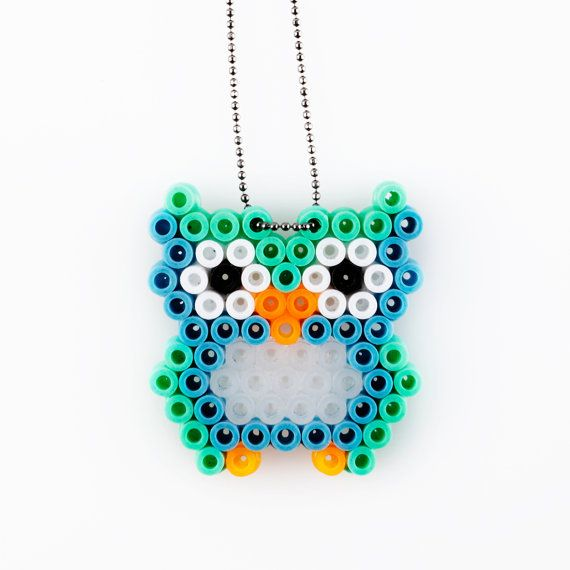 We've been all about Perler beads around here. I never would have thought about turning a piece into a necklace. Owl pendant hama beads by VingborgDesign