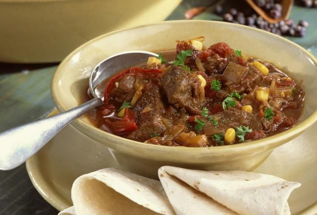 An old fashioned beef stew with spices and thickened broth. Beef stew with potatoes in the crock pot.