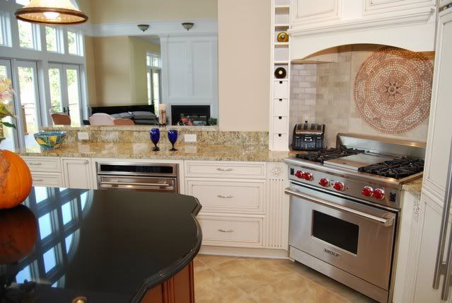 Golden Aurora Granite With White Cabinets And Absolute