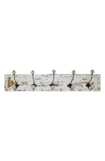 Crystal Art Gallery Farmhouse Wall Hooks at Nordstrom.com. A distressed, whitewashed wooden board makes a vintage-chic backdrop for a set of metal wall hooks tipped with glossy ceramic knobs.