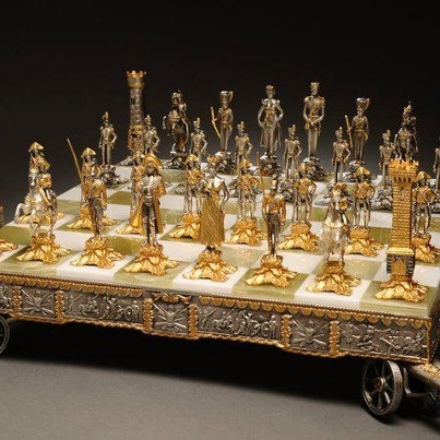 "The Battle of Waterloo Chess Set, Handcrafted in Bronze, Gold & Silver Plated Board & Pieces.  Made in Italy, Size 21""x 21"".  $9,500.00"