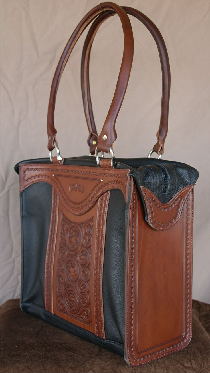 """Zipper Tote - This handsome bag features two inside pockets and one out, full top zipper and tote handles.  Made of supple garment leather with tooled leather accents.  Measures 12"""" H x 12"""" W x 5"""" D"""