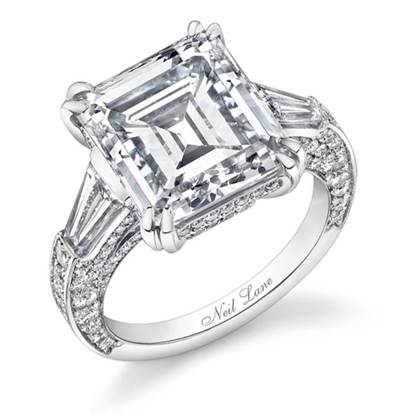 Emerald-cut diamond and platinum architectural ring by Neil Lane.