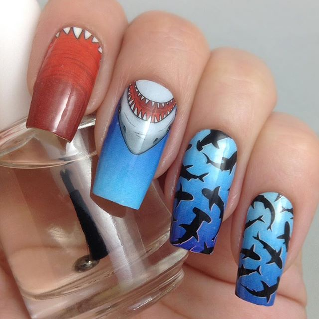 Can't look at these wraps the same way without thinking of Dwayne @therock Johnson as Maui. #SharkHead (Visit @iamdeliasnails for more beautifully dressed talons)  #Moana #EspionageCosmetics #Sharks #TheRock #Cosplay #GeekGirl #Pixar #Disney #Instanails #NerdManicure #NOTD #Nails #NailArt