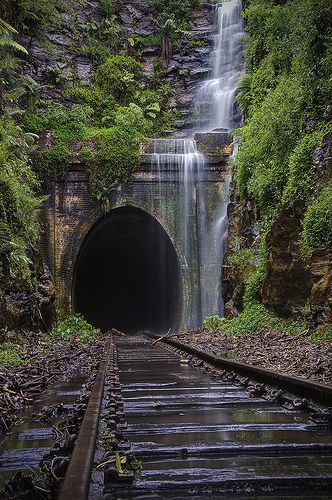 Abandoned Falls by Cat. M, lovely railroad tunnel with waterfall